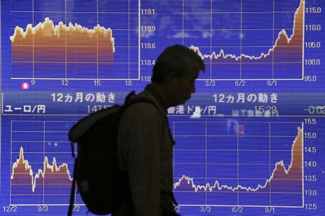 Les économistes arguent depuis des années que le... (PHOTO KOJI SASAHARA, AP)