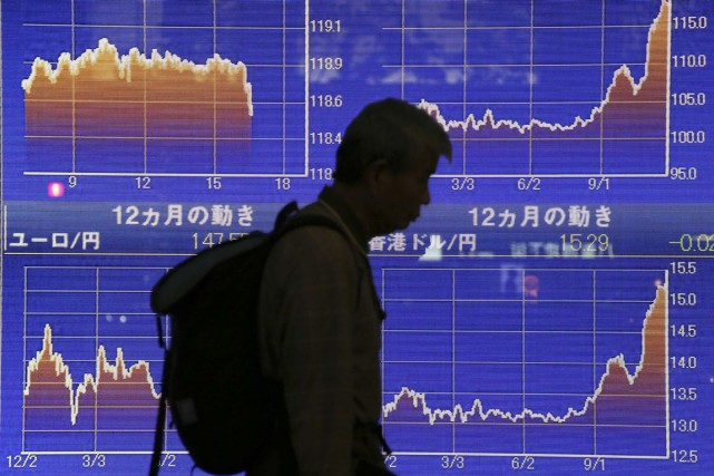 Moody's avait justifié lundi la dégradation de la... (PHOTO KOJI SASAHARA, ARCHIVES AP)