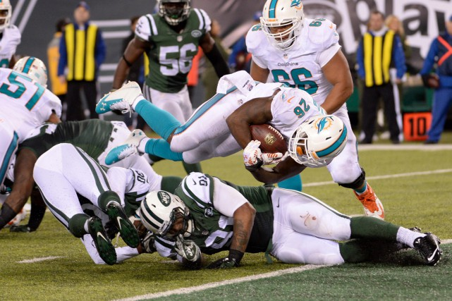 Lamar Miller (26) a réussi un touché pour... (Photo Robert Deutsch, USA Today Sports)