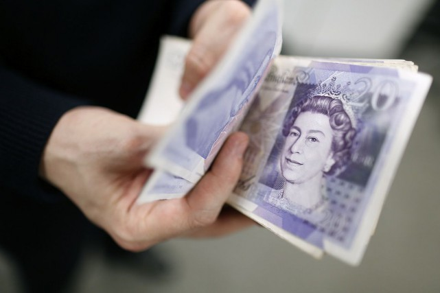 La nouvelle taxe doit rapporter 1 milliard de... (Photo Simon Dawson, Archives Bloomberg)