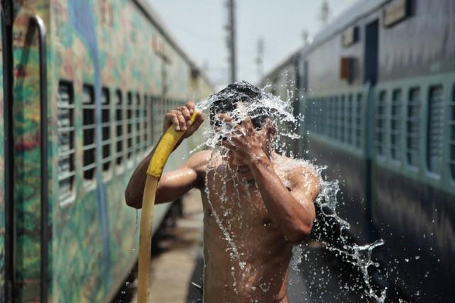 2014 pourrait bien être l'année la plus chaude... (PHOTO CHANNI ANAND, ARCHIVES AP)