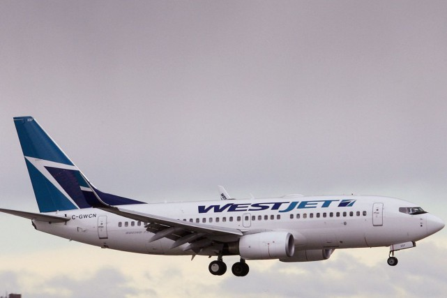 WestJet Airlines (T.WJA) a continué d'observer une croissance... (PHOTO ARCHIVES REUTERS)