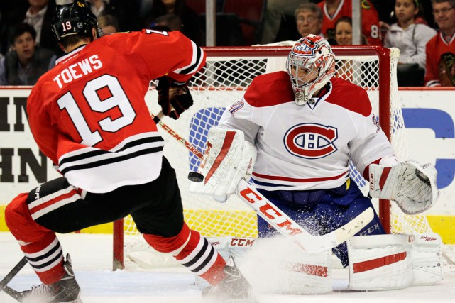 Jonathan Toews et Carey Price... (Photo Nam Y. Huh, archives AP)
