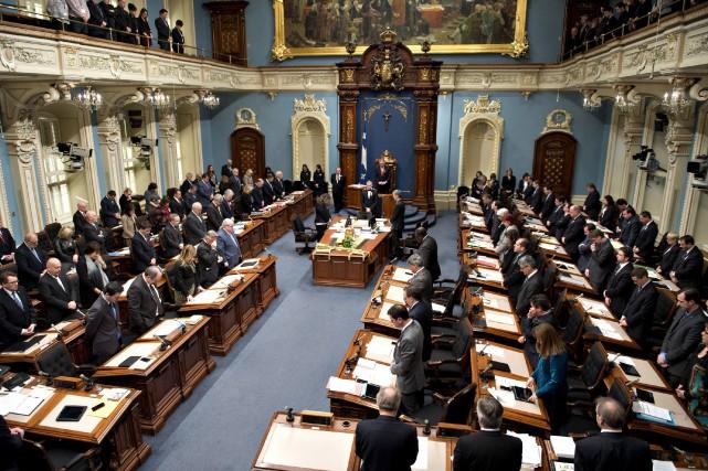 Les députés de l'Assemblée nationale ont rendu hommage... (Photo Jacques Boissinot, La Presse Canadienne)