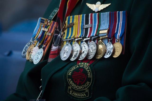 Les anciens et actuels membres des Forces armées... (PHOTO DARRYL DYCK, ARCHIVES LA PRESSE CANADIENNE)