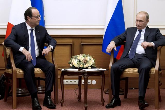 François Hollande et Vladimir Poutinedoivent discuter de la... (PHOTO ALAIN JOCARD, AFP)