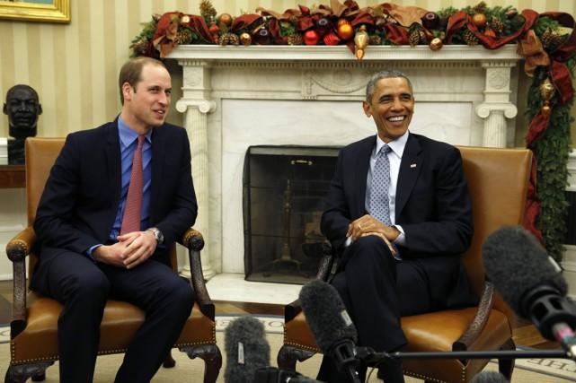 Assis côte à côte, le président américain et... (PHOTO KEVIN LAMARQUE, REUTERS)