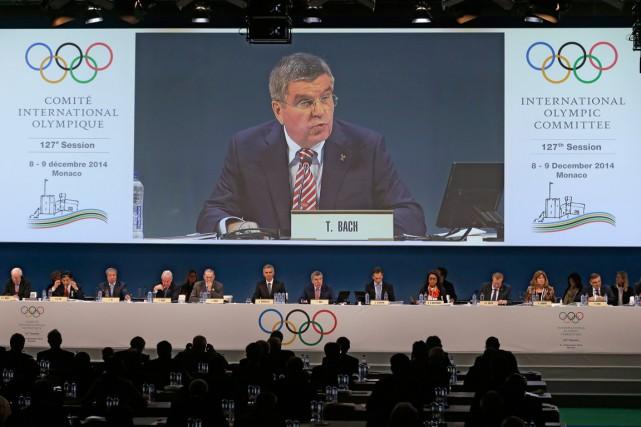 Le président du Comité international olympique, Thomas Bach,... (Photo Lionel Cironneau, AP)