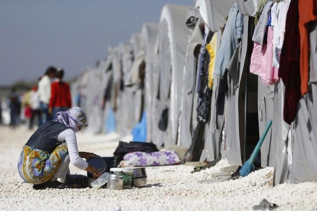 Cela représenterait 5% des 3,6 millions de réfugiés... (PHOTO OSMAN ORSAL, ARCHIVES REUTERS)