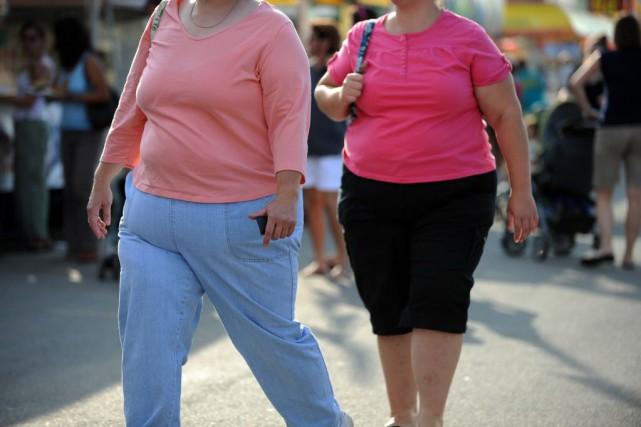 L'obésité est associée à une multitude de problèmes... (PHOTO Tim Sloan, AFP)