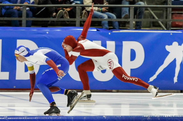 Laurent Dubreuil (à droite) a remporté le bronze... (Photo Michael Kooren, Reuters)