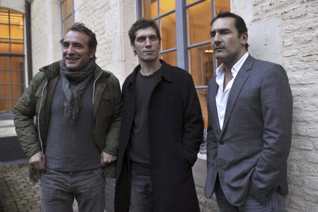 Jean Dujardin et Gilles Lellouche entourent Cédric Jimenez... (Photo AFP)