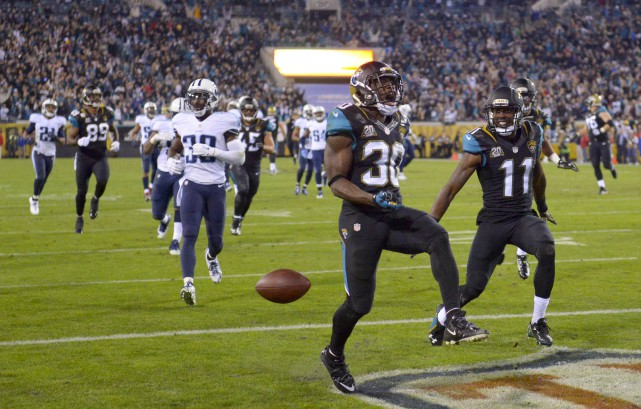 Jordan Todman (30)... (Photo Kirby Lee, USA Today Sports)