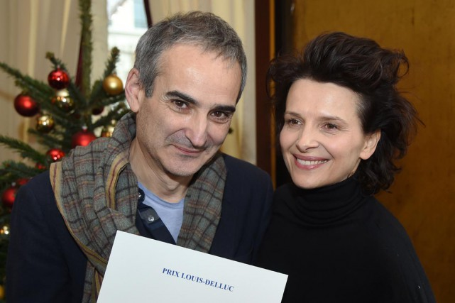 Olivier Assayas et Juliette Binoche... (PHOTO DOMINIQUE FAGET, AFP)