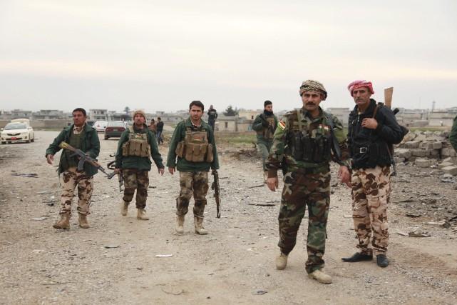 Des soldats de forces de sécurité kurdes ontpermis... (Photo Ari Jalal, archives Reuters)
