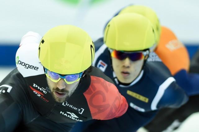 Charles Hamelina maintenant quatre médailles individuelles cette saison.... (PHOTO JOHANNES EISELE, ARCHIVES AFP)