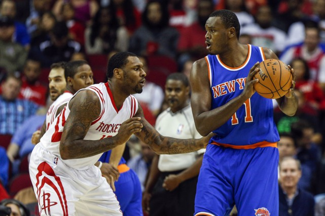 Le coup de coude de Samuel Dalembert (11) lui... (PHOTO TROY TAORMINA, ARCHIVES USA TODAY)