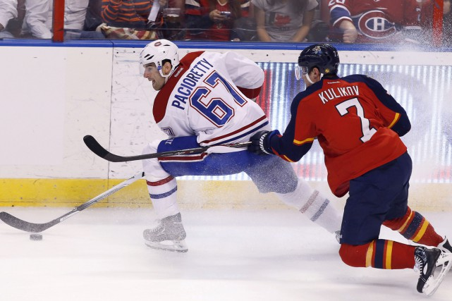 Max Pacioretty (67) tente d'échapper à la couverture... (PHOTO ROBERT MAYER, ARCHIVES USA TODAY)