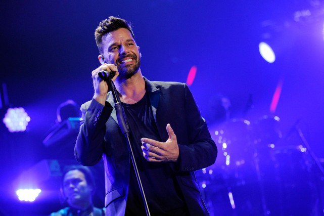 Ricky Martin, 42 ans, a entamé sa carrière... (PHOTO: Chris Pizzello/Invision/AP)