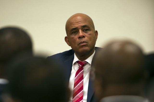 Le président Michel Martelly devrait convoquer les parlementaires... (Photo Hector RETAMAL, archives AFP)