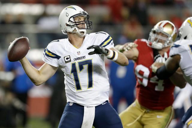 Le quart-arrière des Chargers de San Diego, Philip... (Associated Press, Ben Margot)