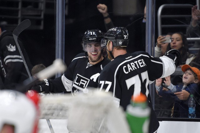 Anze Kopitar et Jeff Carter... (Photo Mark J. Terrill, AP)
