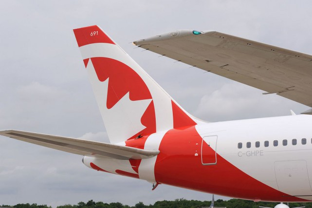 Air Canada et son transporteur à rabais Air Canada Rouge sont visés par une... (PHOTO AIR CANADA)
