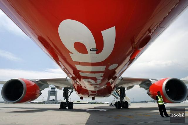 Un avion de la compagnie AirAsia... (Photothèque Le Soleil)