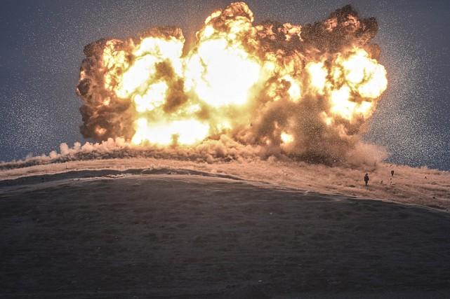 Pendant que les bombardements se poursuivent sur les... (Photo AFP, Bulent Kilic)