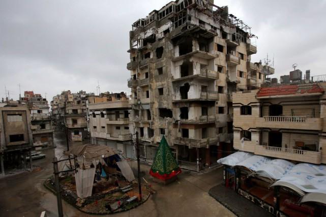Selon l'OSDH, de nombreux prisonniers à Homs ont... (PHOTO YOUSSEF KARWASHAN, AFP)