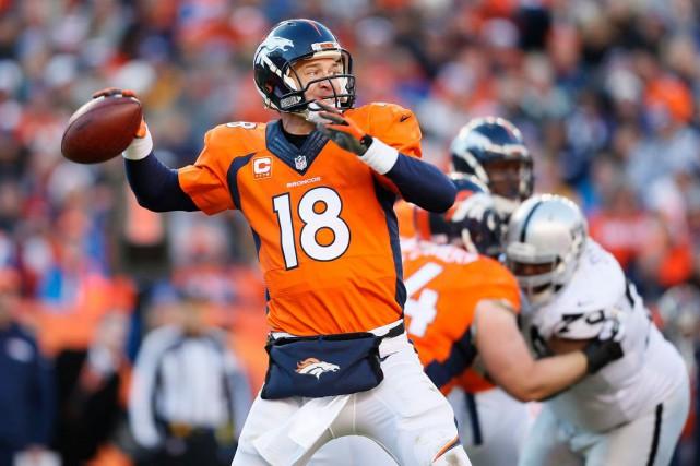 Peyton Manning imite son patron John Elway, des... (Archives AP)