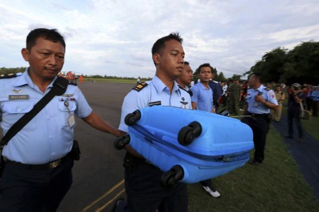 Des experts étrangers doivent rejoindre les enquêteurs indonésiens... (Photo Reuters)
