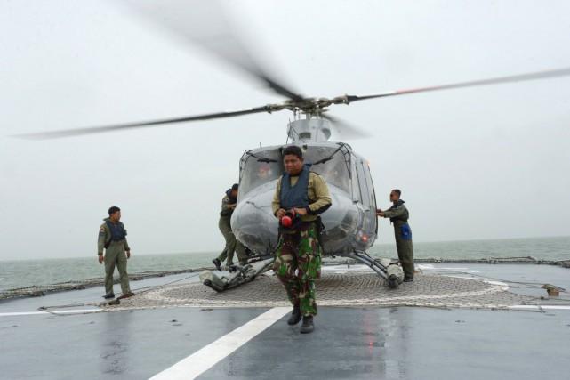 Des responsables des opérations de recherches ont indiqué... (PHOTO ADEK BERRY, AFP)