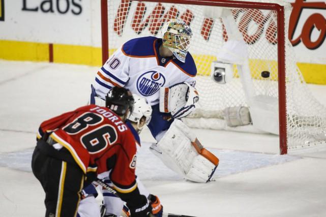 Les Flames de Calgary ont récolté une victoire... (Photo Jeff McIntosh, La Presse canadienne)