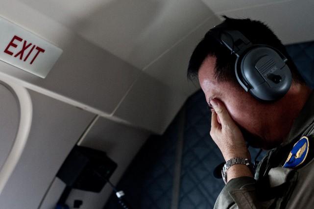 Quatre grandes parties de l'appareil ont été retrouvées... (Photo JUNI KRISWANTO, AFP)