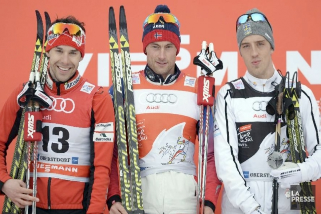 Le podium de la poursuite de 15 km... (AFP, Christof Stache)