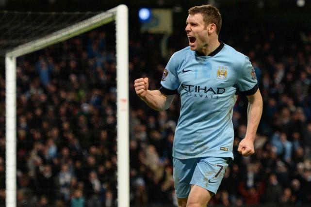 Les deux buts de James Milner ont permis... (PHOTO OLI SCARFF, AFP)