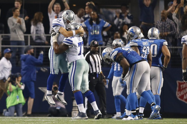 Tony Romo a lancé deux passes de touché en direction de Terrance Williams, la... (Photo Tim Heitman, USA Today Sports)