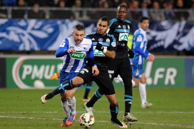 Marseille, le leader du championnat de France, a été éliminé en 32e de finale... (Photo: AFP)