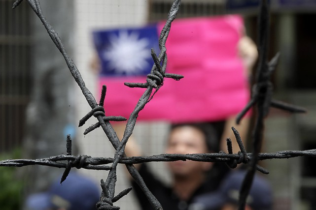 Dotée de son propre gouvernement, Taïwan est de... (Photo archives Reuters)