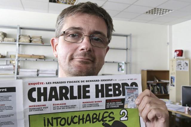Le dessinateurCharb (ici photographié en 2012) était sous... (Archives AP)