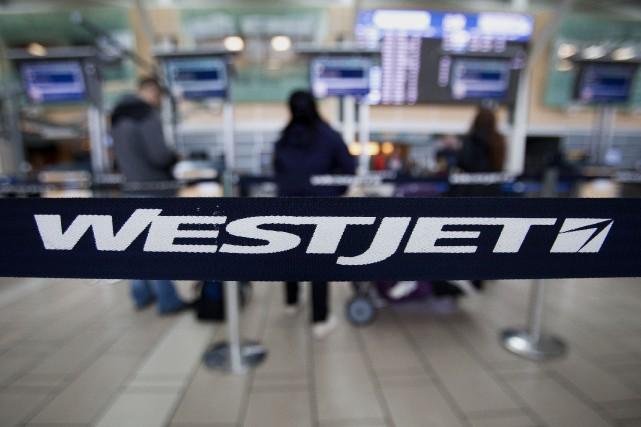 Le transporteur aérien WestJet Airlines (t.wja) a vu son... (Photo archives Bloomberg)