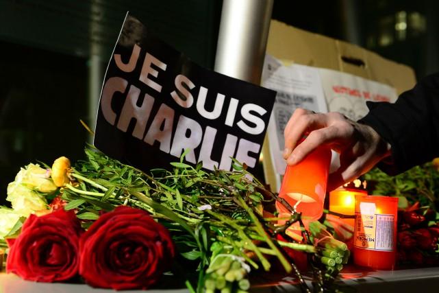 Le terrible attentat dont ont été victimes des journalistes de l'hebdomadaire... (Photo  JOHN MACDOUGALL, Agence France-Presse)