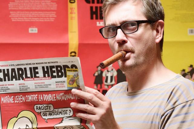 Le dessinateur-vedette et directeur de Charlie Hebdo, Stéphane... (Photo AFP)