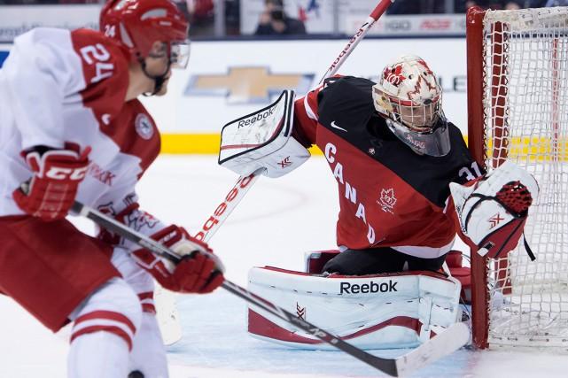 Après avoir aidé le Canada à remporter la... (LA PRESSE CANADIENNE, Frank Gunn)