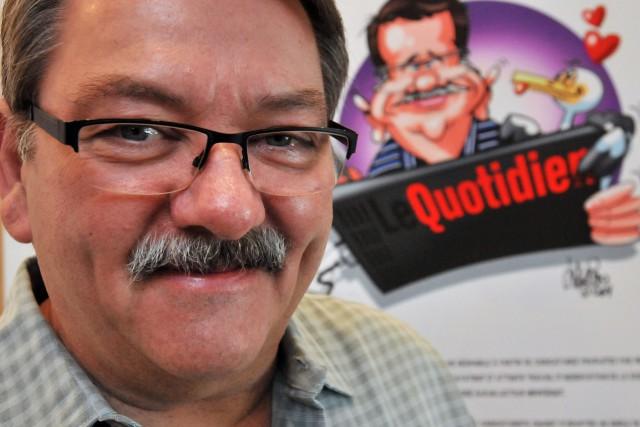 Le caricaturiste du Quotidien, Mario Lacroix, s'est dit... ((Archives))