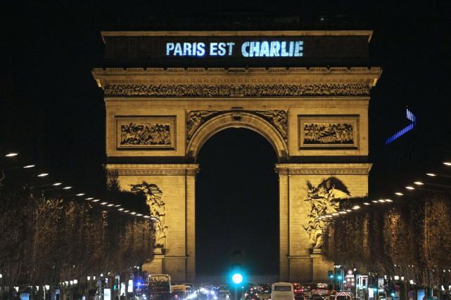 Paris et toute la France étaient en deuil,... (Photo AFP)
