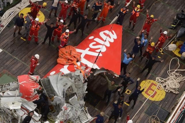 La queue de l'Airbus pourrait contenir la boite... (PHOTO PRASETYO UTOMO, AFP)