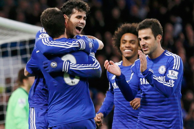Diego Costa (au centre) a inscrit son 15e but... (PHOTO STEFAN WERMUTH, REUTERS)
