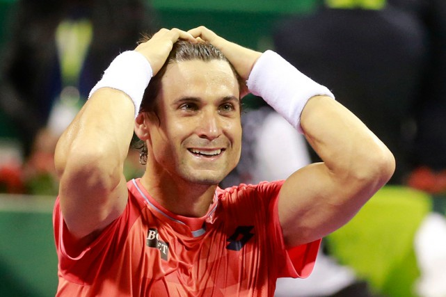 David Ferrer... (PHOTO MOHAMMED DABBOUS, REUTERS)